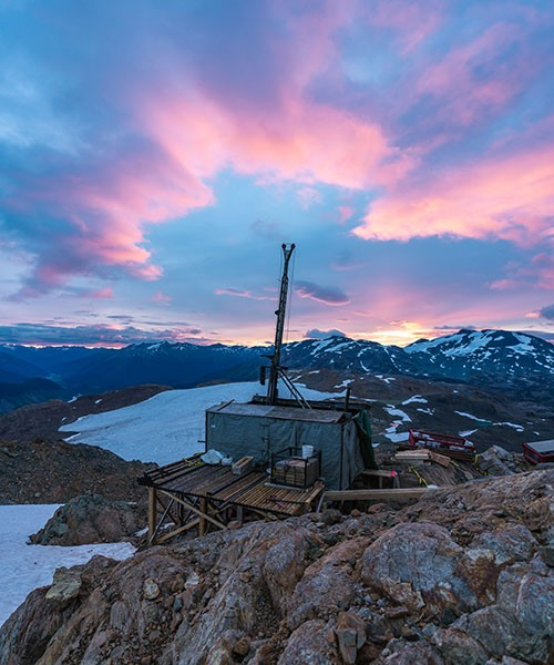 A diamond drill rig assembled by helicopter sits on a wooden drill pad at an elevation of 6,000 feet in northwestern British Columbia.